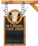 Steak House - Blackboard with Chain Stock Image