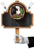Steak House - Blackboard with Hand of Waiter Royalty Free Stock Image