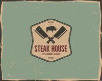 Steak house poster or logo design. Bar and grill logotype, emblem. Food label in retro colors style. Stock badge. Isolated on scratched background Royalty Free Stock Photo