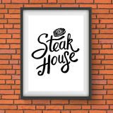 Steak House Restaurant Sign Hanging on Brick Wall Stock Images