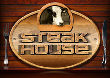 Steak House - Sign with Cow and Cutlery Stock Photos