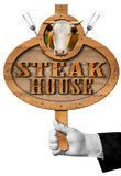 Steak House -  Sign with Hand of Waiter Stock Image