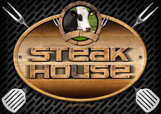 Steak House - Sign with Kitchen Utensils Stock Image
