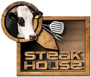 Steak House - Sign with Kitchen Utensils Stock Images