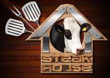 Steak House Sign on Wooden Wall Royalty Free Stock Images
