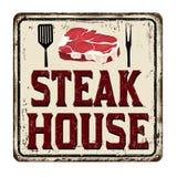 Steak house vintage rusty metal sign Stock Photos