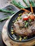Steak in the iron pan Stock Photo
