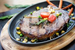 Steak in the iron pan Royalty Free Stock Image
