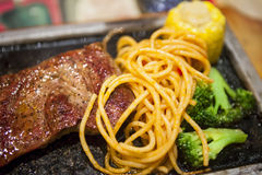 Steak with Italy noodles Royalty Free Stock Photography