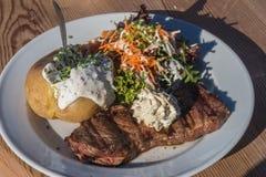 Steak, jacket potato and salad Royalty Free Stock Image