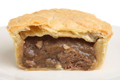 Steak & Kidney Meat Pie. Freshly baked individual steak and kidney pie sliced open Stock Photography