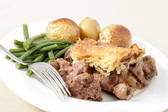 Steak and kidney pie with fork Royalty Free Stock Photography