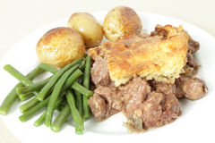 Steak and kidney pie on plate Royalty Free Stock Photos