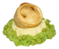 Steak And Kidney Pudding With Mashed Potato And Peas Stock Photos