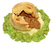 Steak And Kidney Pudding With Mashed Potato And Peas Stock Photo