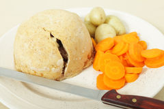 Steak and kidney pudding ready to serve Stock Image