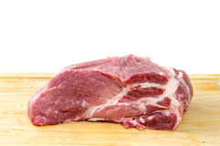 Steak on a kitchen board Stock Images