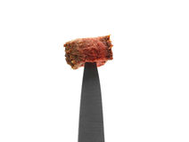 Steak on a knife close up Royalty Free Stock Photos
