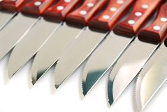 Steak knives row Royalty Free Stock Photos
