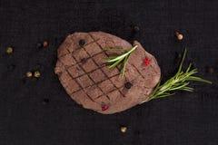 Steak on lava rock. Stock Image