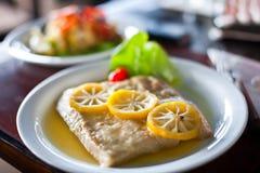 Steak in lemon sauce Stock Images