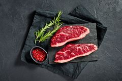 Steak of marbled beef black Angus. Black background, top view. stock photography