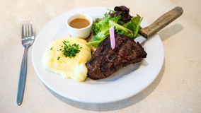 Steak with mashed potatoes and salad meal Stock Images