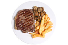 Steak Meal. Seasoned sirloin steak with crinkle-cut fries and sauteed mushrooms on a white ceramic plate Royalty Free Stock Photos