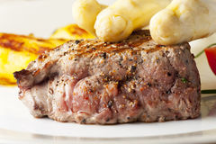 Steak on a meat fork Stock Photos