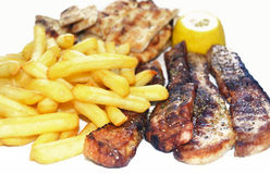 Steak meat with fried potatoes and greek pita Royalty Free Stock Image