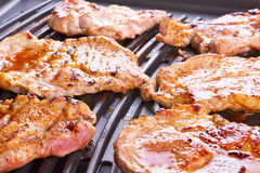 Steak meat grilled on barbecue. Steak meat grilled on electric barbecue Royalty Free Stock Image