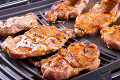 Steak meat grilled on barbecue. Steak meat grilled on electric barbecue Stock Image