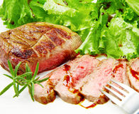 Steak meat grilled with rosemary and lettuce Royalty Free Stock Image