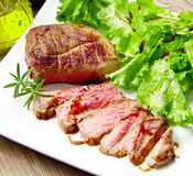 Steak meat grilled with rosemary and lettuce Stock Images