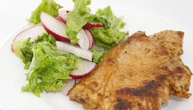 Steak meat grilled with salad made with radish, fresh lettuce. And olive oil, in a white plate. Selective focus Stock Image
