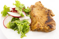 Steak meat grilled with salad made with radish, fresh lettuce an. D olive oil, in a white plate. Selective focus Stock Images