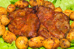 Steak meat grilled with salad. A tasty Steak meat grilled with lettuce and potato Royalty Free Stock Photography
