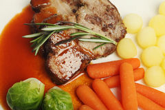 Steak meat with rosemary and vegetables Royalty Free Stock Photos