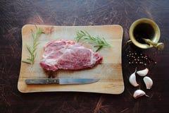 Steak meat on wooden desk Stock Photos