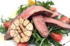Steak mit Knoblauch Stockfotos