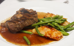 Steak with Mushroom Gravy and Vegetables Royalty Free Stock Photos