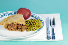 Steak and mushroom meat pie with vegetables Royalty Free Stock Photo