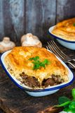 Steak and mushroom pie. On rustic wooden backgournd royalty free stock photo