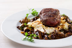 Steak with mushroom sauce Royalty Free Stock Photo