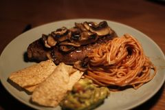 Steak With Mushroom And Spaghetti Stock Photo