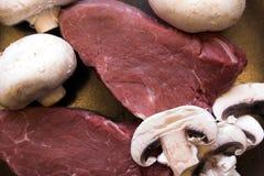 Steak & Mushrooms. Fillet steak & mushrooms ready for dinner Royalty Free Stock Image