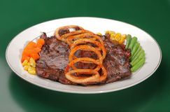 Steak with onion Royalty Free Stock Photo