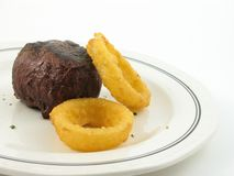 Steak and onion rings Stock Photo