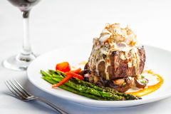 Steak Oscar. A plated meal of steak and crab meat Stock Photos