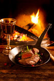 Steak in Pan with Chimney Fire Royalty Free Stock Photo
